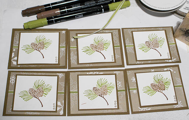 A set of six card toppers made with the same supplies
