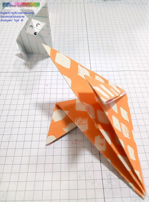 Origami fox face and ears.
