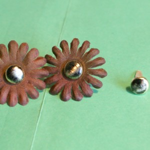metal embellishments, clear adhesive, rub ons, altered art