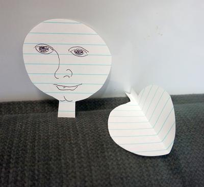 Cut two pieces the same, one with a face.