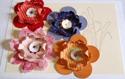 More embossed or pierced paper flowers