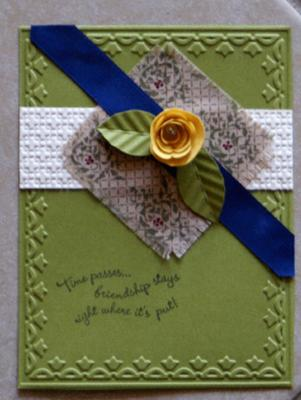 A rose made with a scalloped circle punch adorns this card