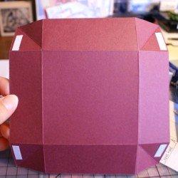 Adhering box lid corners