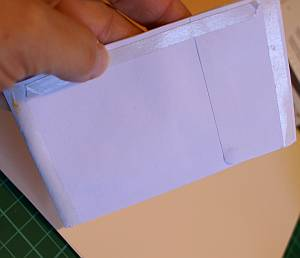 Adhere along the top and the sides of the envelop pockets