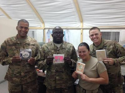 Military Personelle receiving some cards
