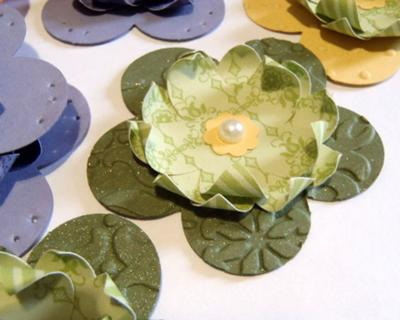Punched, embossed, and shimmer paint sprayed flowers
