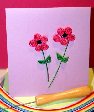 Two quilled flowers