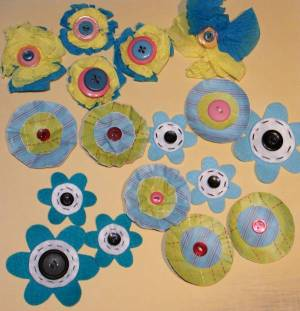 Flowers made from punched circles, distressing tools, etc